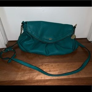 Teal Juicy Couture bag  with strap.